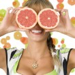 Grapefruit and glasses — Stock Photo
