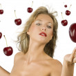 Blond girl with cherry — Stock Photo