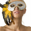 The mask and feather - Stock Photo