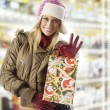 Showing christmas shopping — Stock Photo