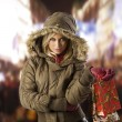 Girl in jacket winter with shopping bag — Stock fotografie