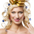 Christmas girl with golden bow — Stock Photo