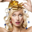 Blond woman with a golden bow — Stock Photo