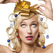 Blond woman with a golden bow — Stock fotografie