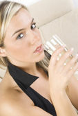 The blond and the wine — Stock Photo