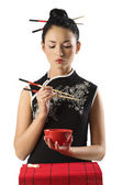 Chinese girl and oriental food — Stock Photo