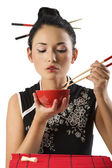 Girl eating oriental food — Stock Photo
