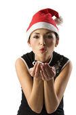 Asian santa claus blowing — Stock Photo