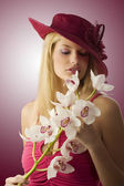 Red hat anf flowers — Stock Photo