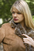 Blond girl with jacket — Stok fotoğraf