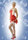 Blond pinup pulling stockings — Stock Photo