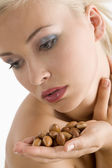 Beauty girl with argan seed — Stock Photo