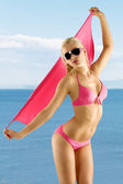 Blond sexy girl in pink bikini and sunglasses — Stock Photo