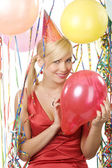 Girl blond with red balloon — Stock Photo