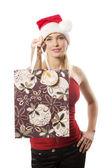 Christmas girl with shopping bag — Stock Photo