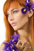 Red hair purple flower — Stock Photo