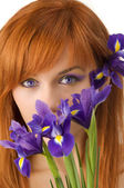 Eyes and flower — Stock Photo