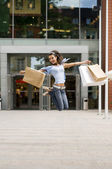 Jumping for shopping — Stock Photo
