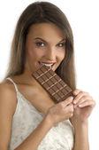 Biting chocolate — Stock Photo