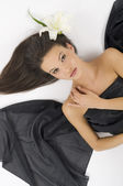 White lily black fabric — Stock Photo