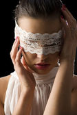 Mask and white lace — Stock Photo
