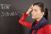 Girl at blackboard — Stock Photo