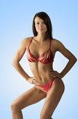 Body builder in red — Stock Photo