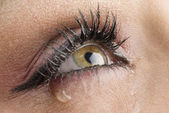 close up on the eyes of a young woman crying — Stock Photo