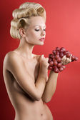 The blond with grape — Stock Photo