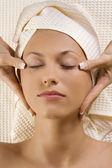 Hands massage on head temple — Stock Photo