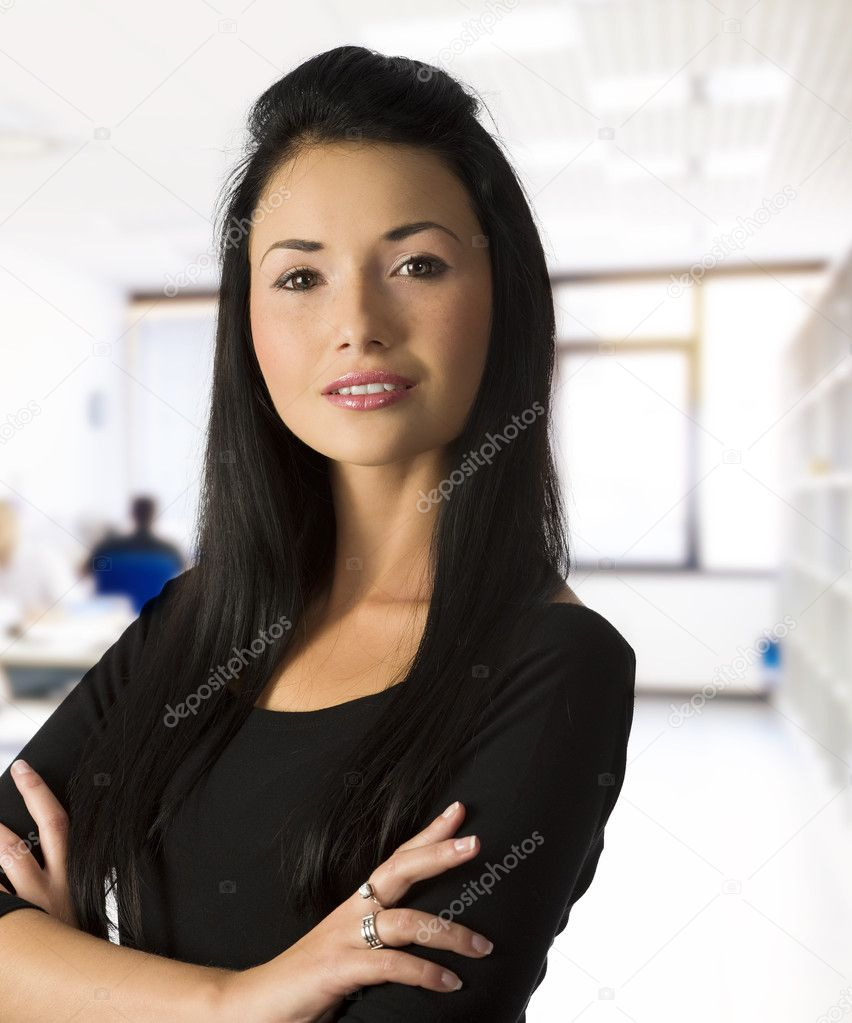 Studio shot of graceful worker asian girl in black dress in office — Stock Photo #4701294