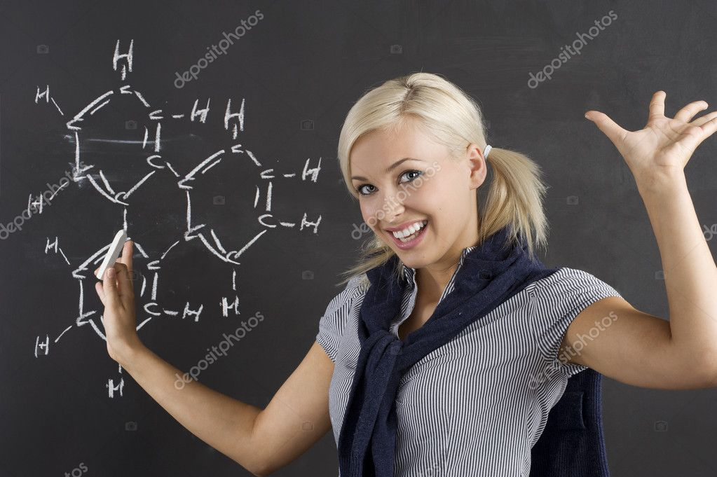 Student enjoing for her chemical lesson in front of blackboard — Stock Photo #4702186