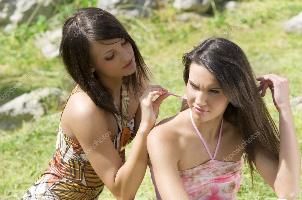 Two girl friends outdoor in the park sitting on the grass — Stock Photo #4702812