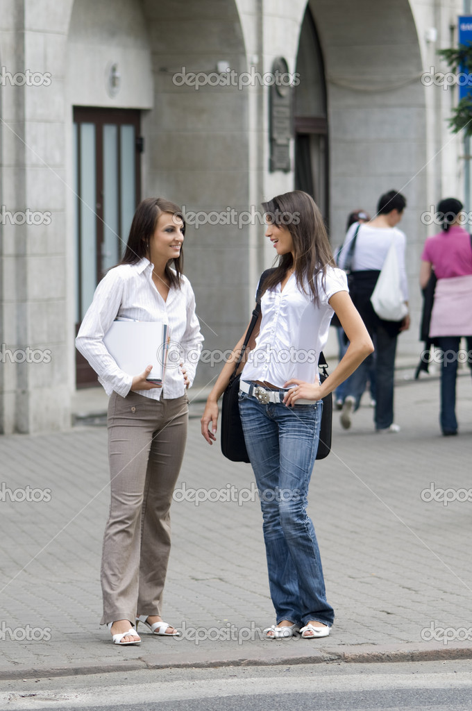 Women chatting on the cross road in city center while they going to work — ストック写真 #4702884