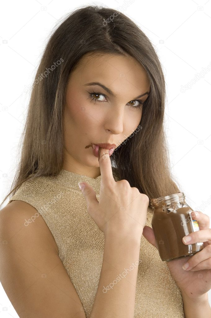 Sensual girl sucking her finger with some chocolate cream on  Stock Photo #4703044