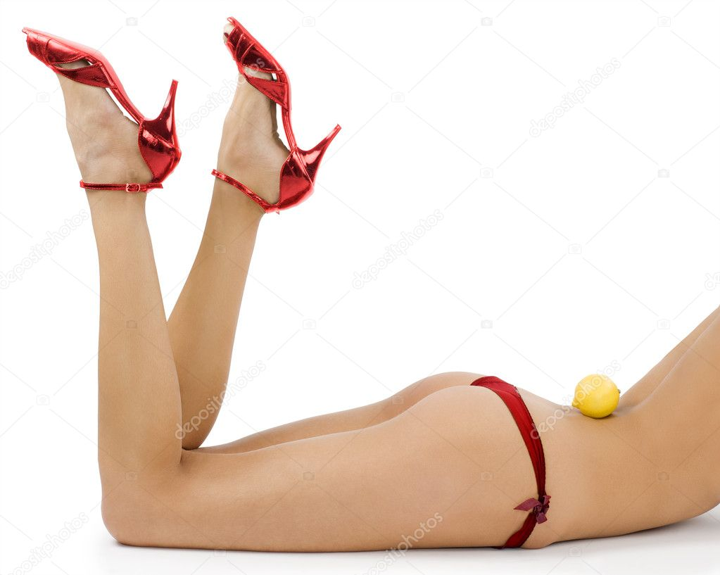 Close up of sexy girl in red panties and red shoes with a lemon on back — Stock Photo #4703118