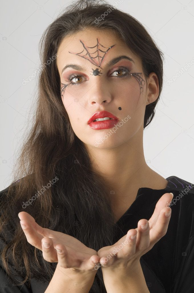 Cute young woman with a spider web painted on face — Stock Photo #4703134