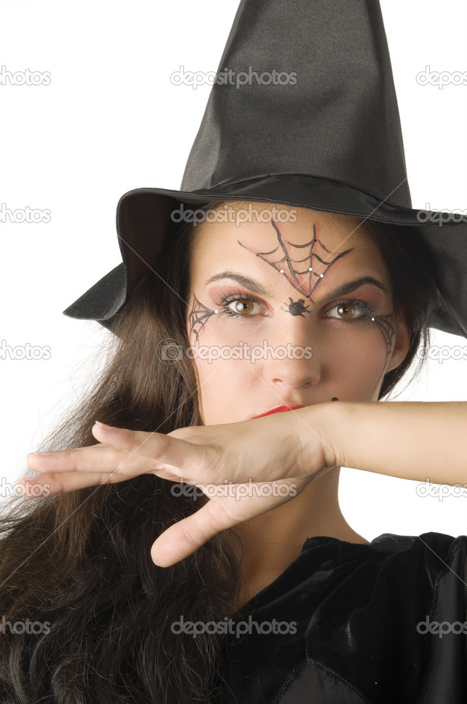 Cute girl with witch hat and a spider web painted on face — Stock Photo #4703137