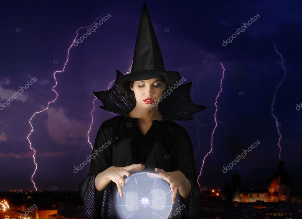 Witch with magic crystal ball and lightning in background — Stock Photo #4703214