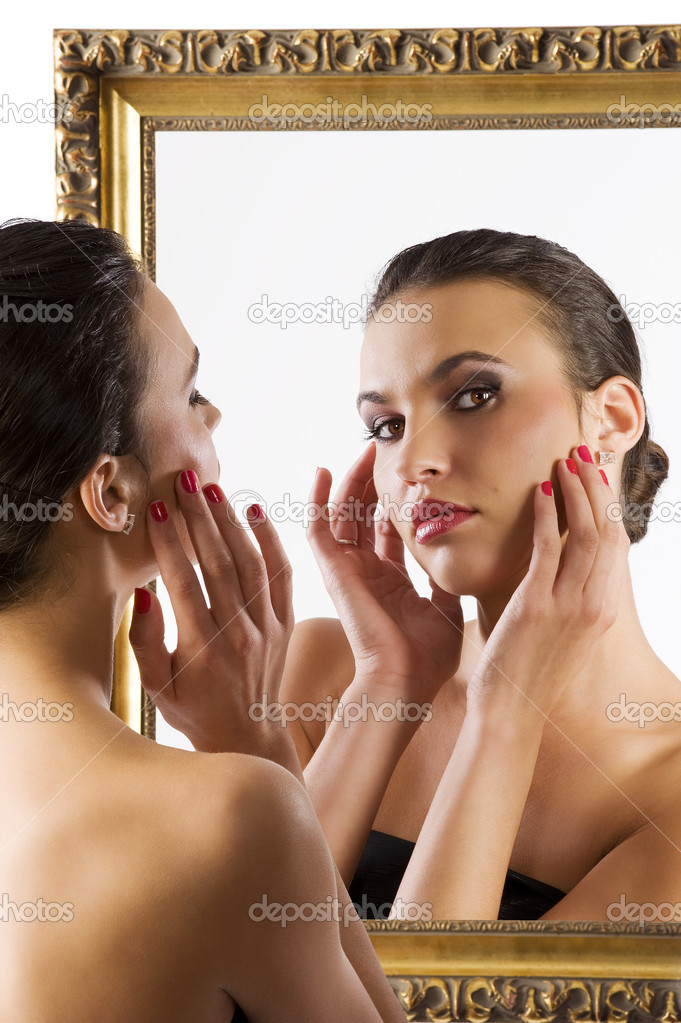 Beauty portrait of young woman looking in camera from the mirror — Stock Photo #4703310