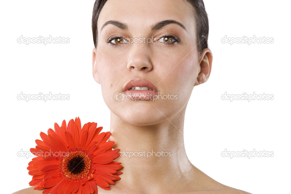 Fresh portrait of a young brunette woman wiith color flower no retouch . natural skin — Stock Photo #4703508
