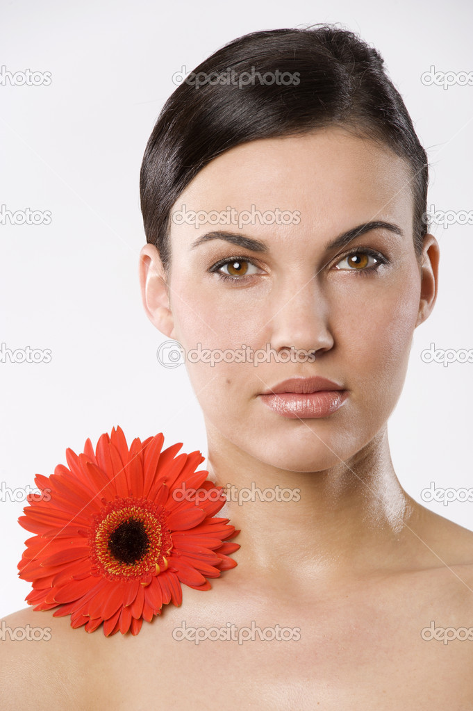 Fresh portrait of a young brunette woman wiith color flower without skin retouch — Photo #4703509