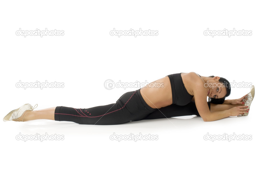 Pretty girl strecthing her body and making gym  Stock Photo #4703969