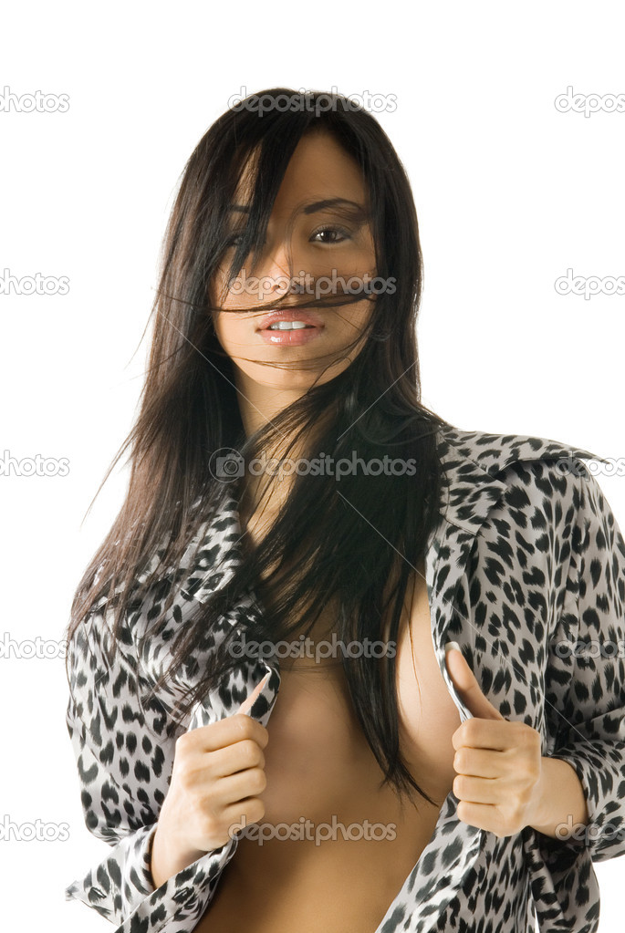 Attractive and sexy brunette hair in wind with leopard shirt — Stock Photo #4704555