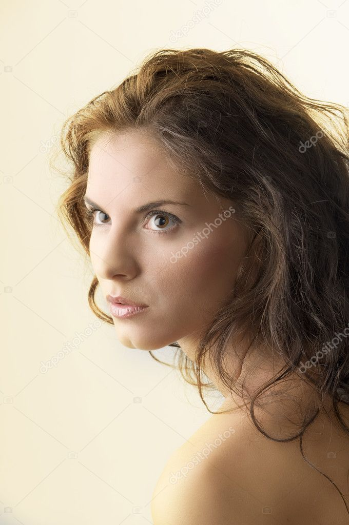 Attractive portrait of a cute brunette with moved hair and strong look — Stock Photo #4705103