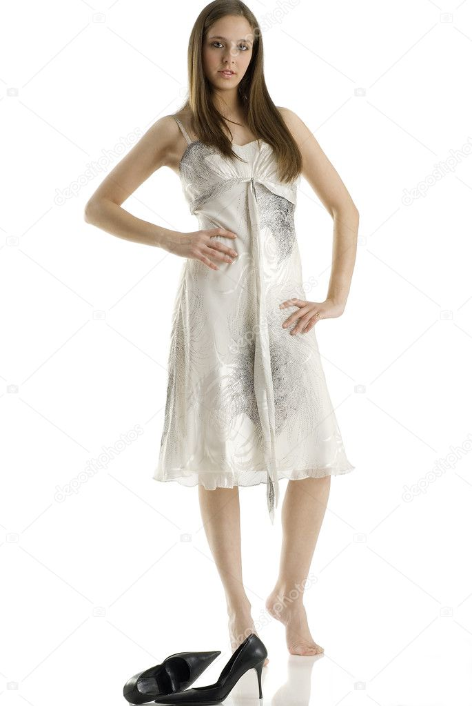 A young woman in very fashionable dress without her shoes — Stock Photo #4705270