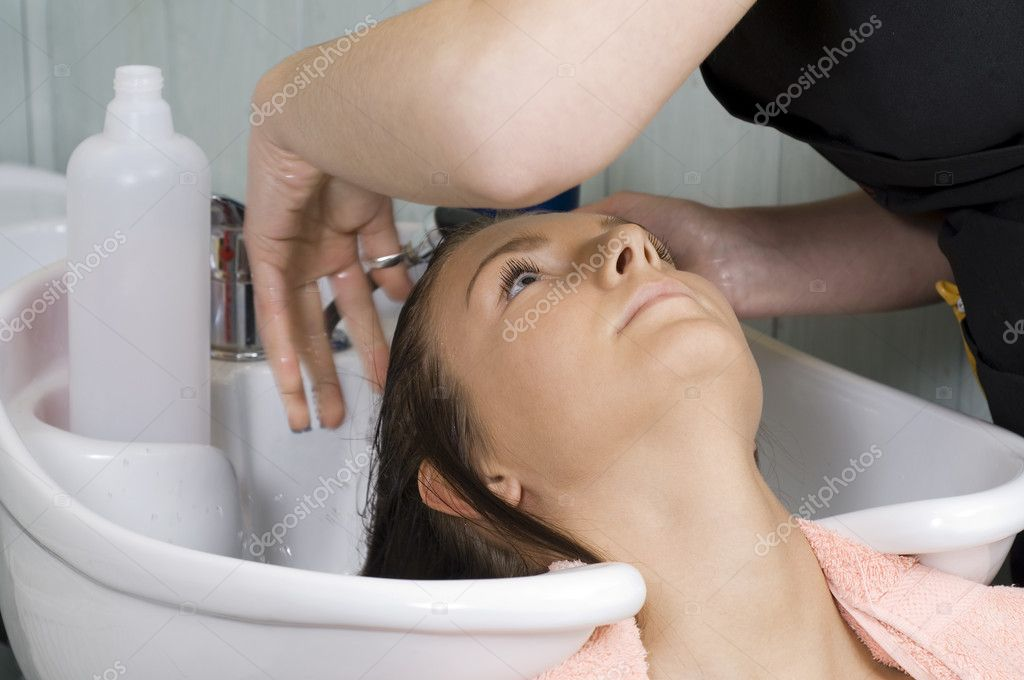Brunette in a salon getting washed her hair — Stock Photo #4705319