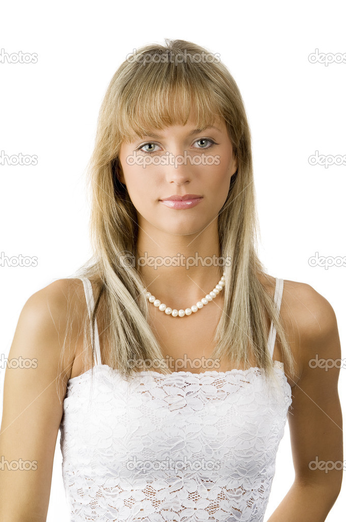 Beautiful young woman in white dress and a necklace — Stock Photo #4705359