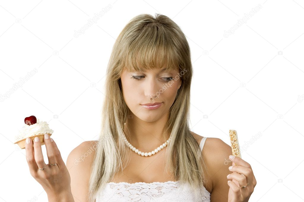Beautiful girl in hesitation to choose between sweet or diet food — Stock Photo #4705360
