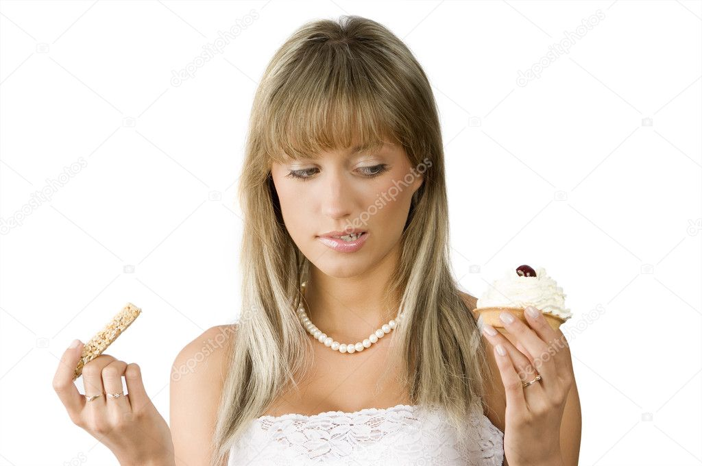 Beautiful girl in hesitation to choose between sweet or diet food  Stock Photo #4705361
